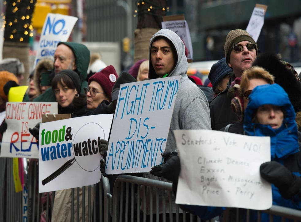 Climate activists rally, to urge politicians to stand against climate denial and hate, January 9, 2017 in New York