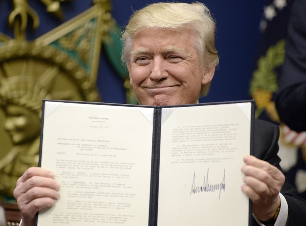 President Donald Trump signs an executive order on the 'extreme vetting' of visa seekers from terror-plagued countries