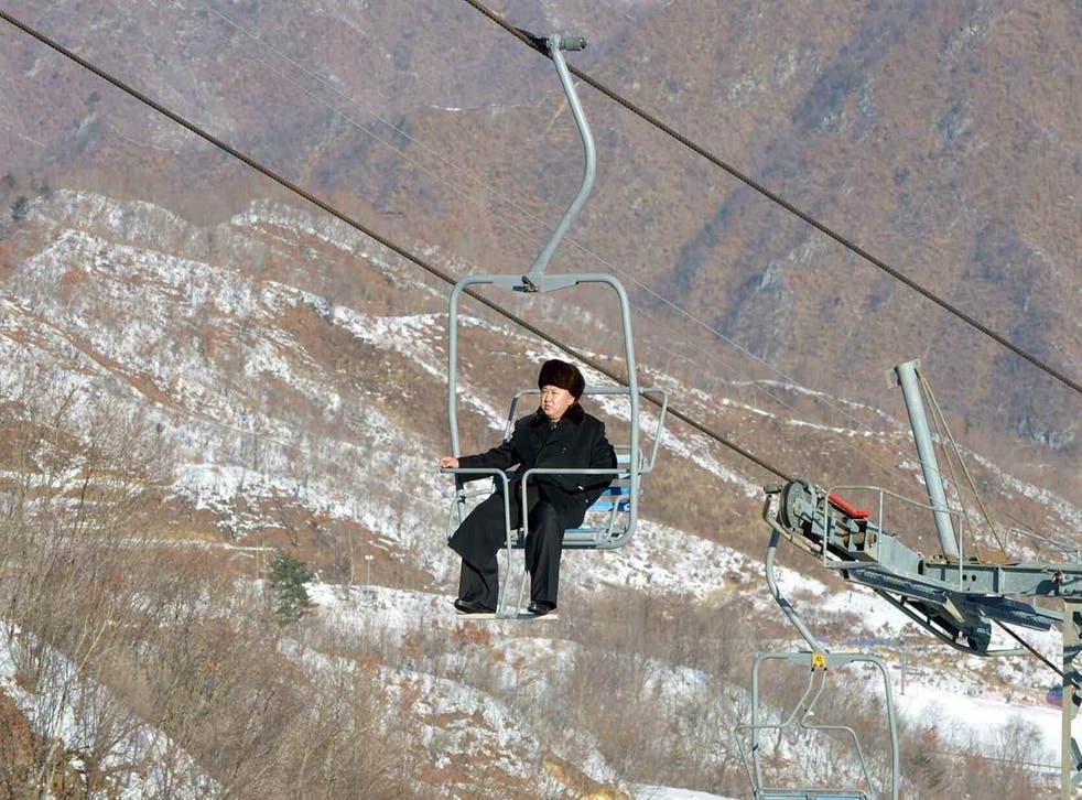 Kim Jong Un rides a ski lift during his inspection tour at the Masikryong resort, near Wonsan, North Korea. Picture: