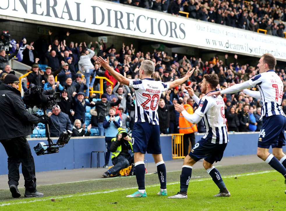 Steve Morison celebrates with fans after scoring his side's first goal