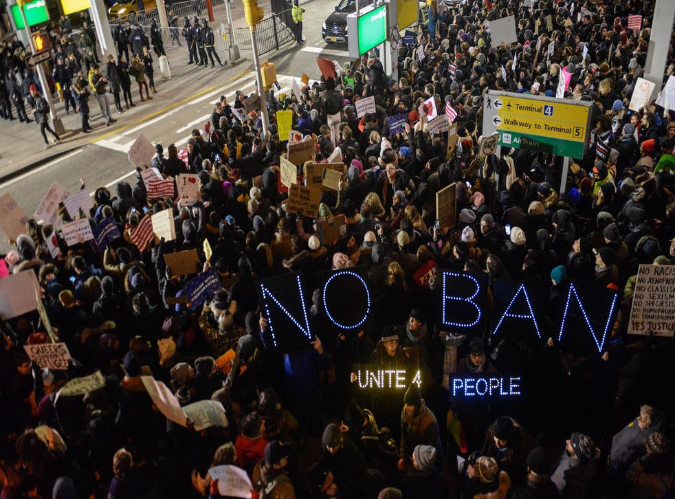 Protests outside Terminal 4 at JFK airport where two Iraqis were detained despite holding valid visas