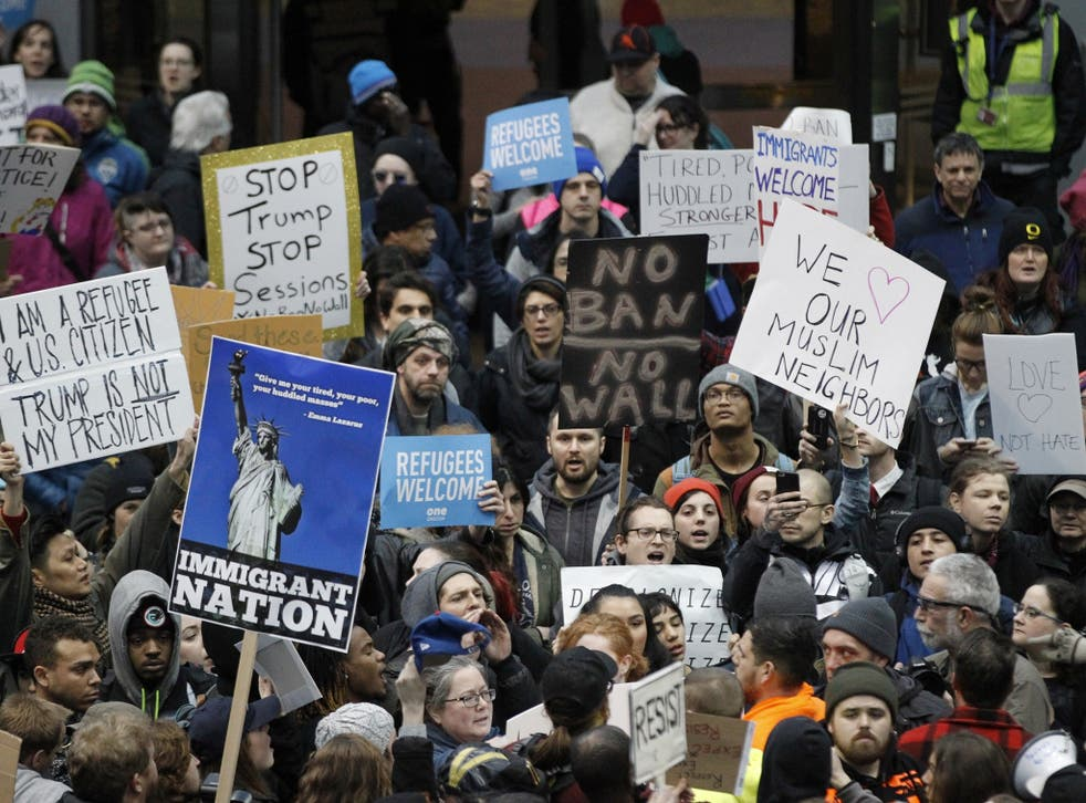 Activists gather at Portland International Airport to protest against President Donald Trump's executive action travel ban in Portland, Oregon
