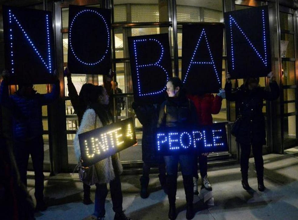 People outside a court house in New York on Sunday protest against Trump's travel order