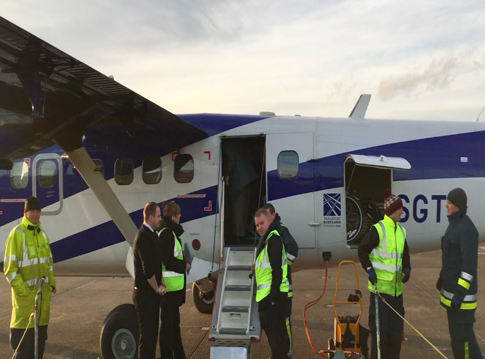 Check mates: staff working on the departure of the Loganair flight to Glasgow