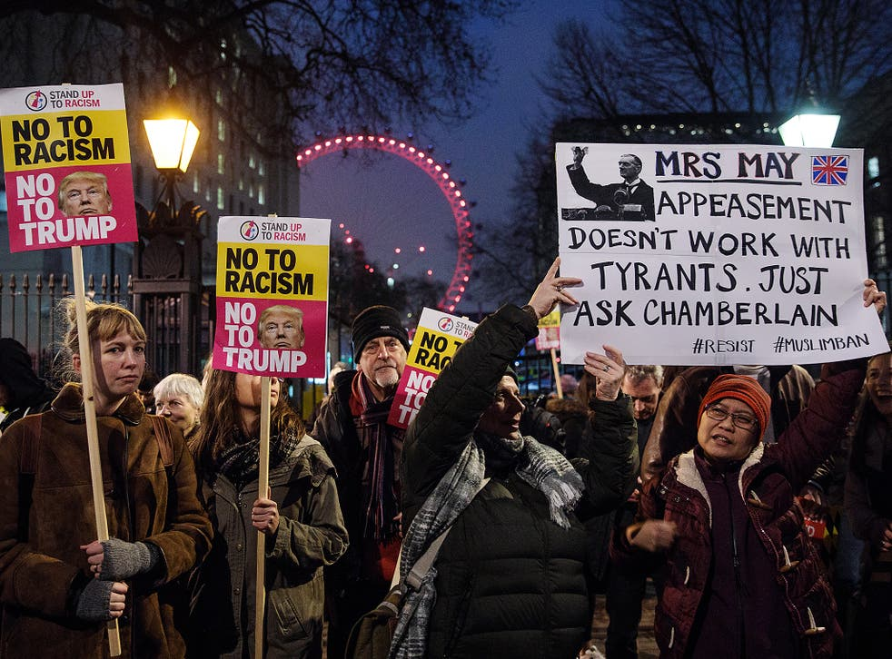 Demonstrators holding placards attend a protest outside Downing Street against U.S. President Donald Trump's ban on travel from seven Muslim countries in London
