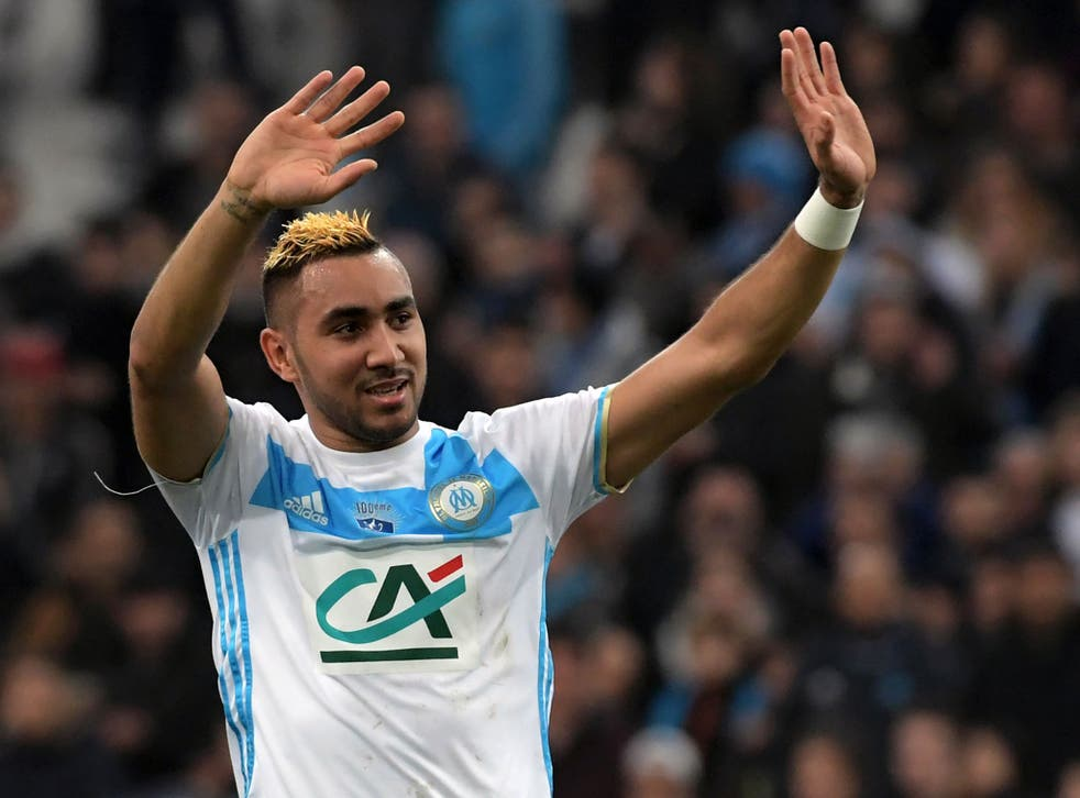 Dimitri Payet waves to the Marseille fans after making his return for the Ligue 1 club