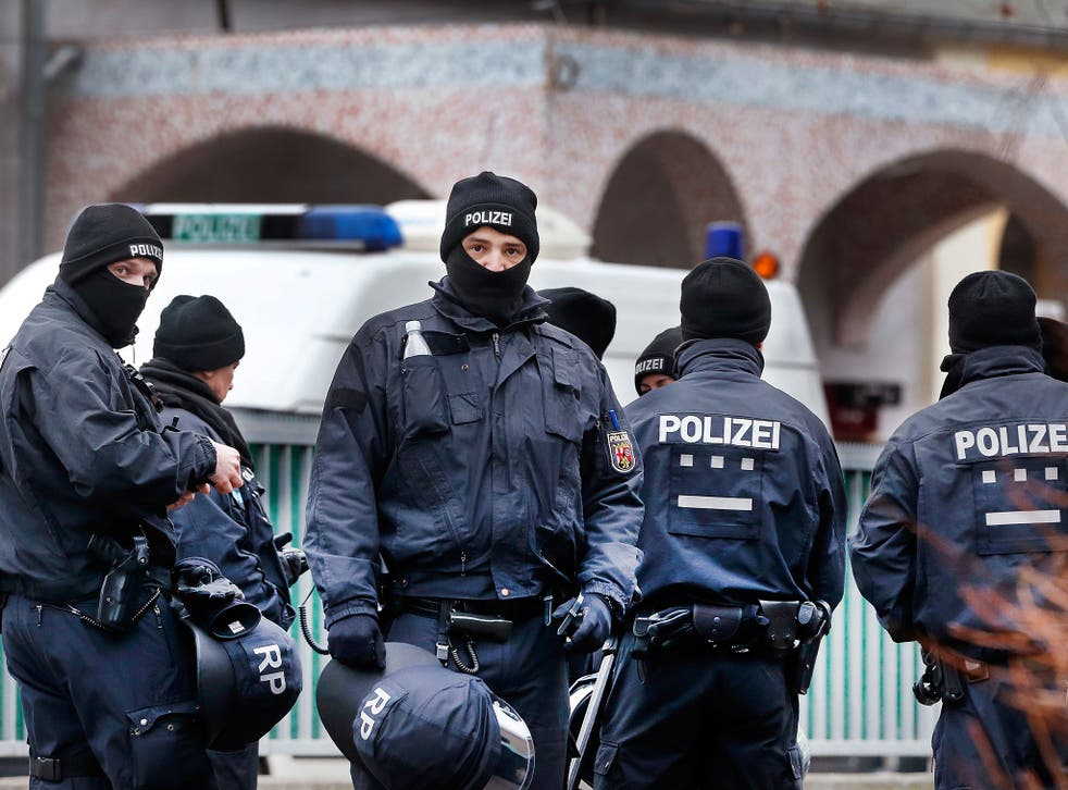 German police officers stand guard in front of a mosque during a terror raid in Frankfurt, Germany, on 1 February