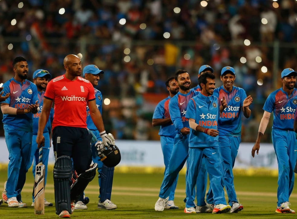 Indian cricketers celebrate their victory over England in their third Twenty20 international cricket match at Chinnaswamy Stadium in Bangalore,