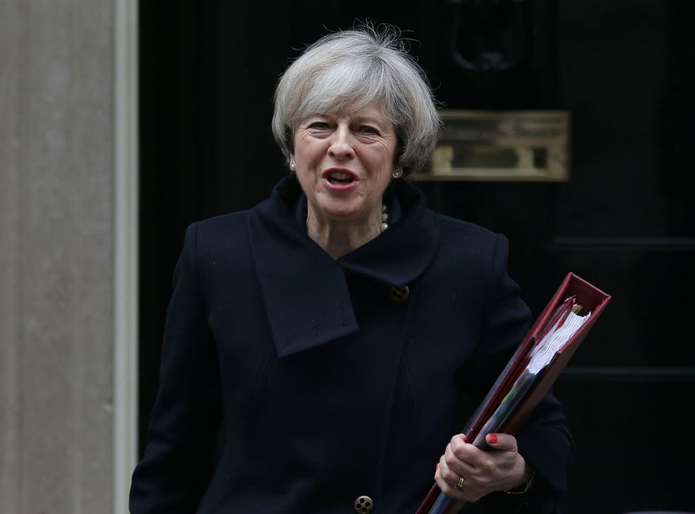 Theresa May leaving Downing Street ahead of PMQs yesterday