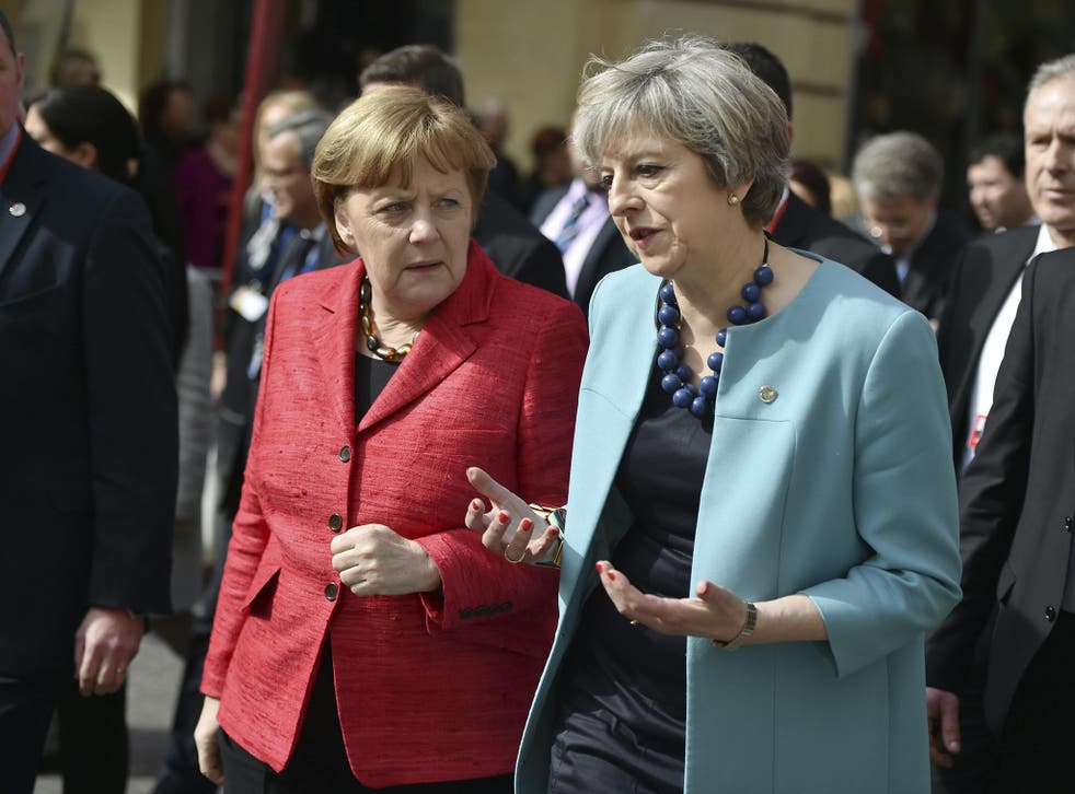 Theresa May chats with Angela Merkel on a walkabout in Malta