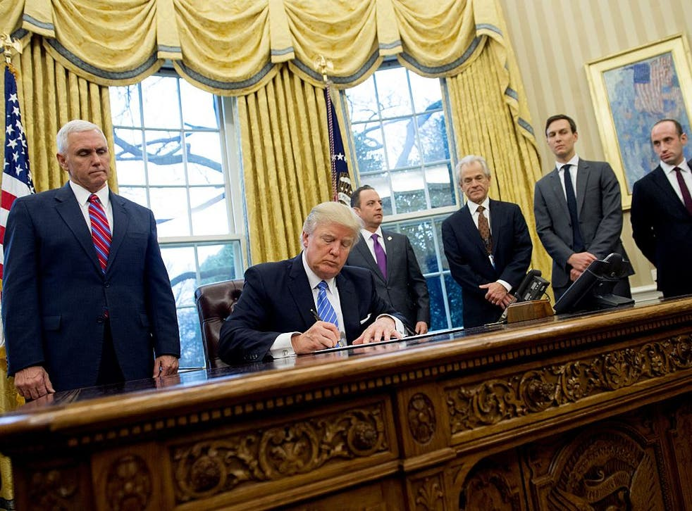 President Trump signs executive orders January 23, 2017.