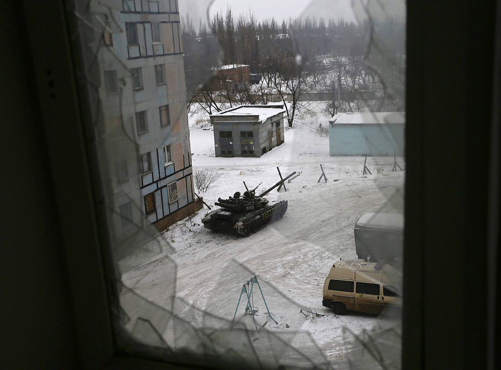 A tank from the Ukrainian Forces is stationed outside a building in the flashpoint eastern town of Avdiivka that sits just north of the pro-Russian rebels' de facto capital of Donetsk