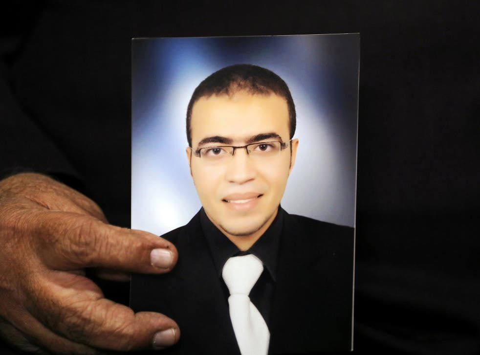 Reda Abdullah al-Hamamy, the father of Abdullah Reda al-Hamamy who is suspected of attacking a soldier in Paris' Louvre museum, holds a picture of his son in Egypt on 4 February