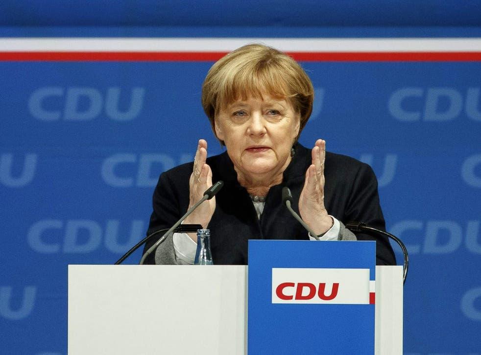 Angela Merkel speaks at the regional party conference of the CDU Schleswig-Holstein in Neumuenster