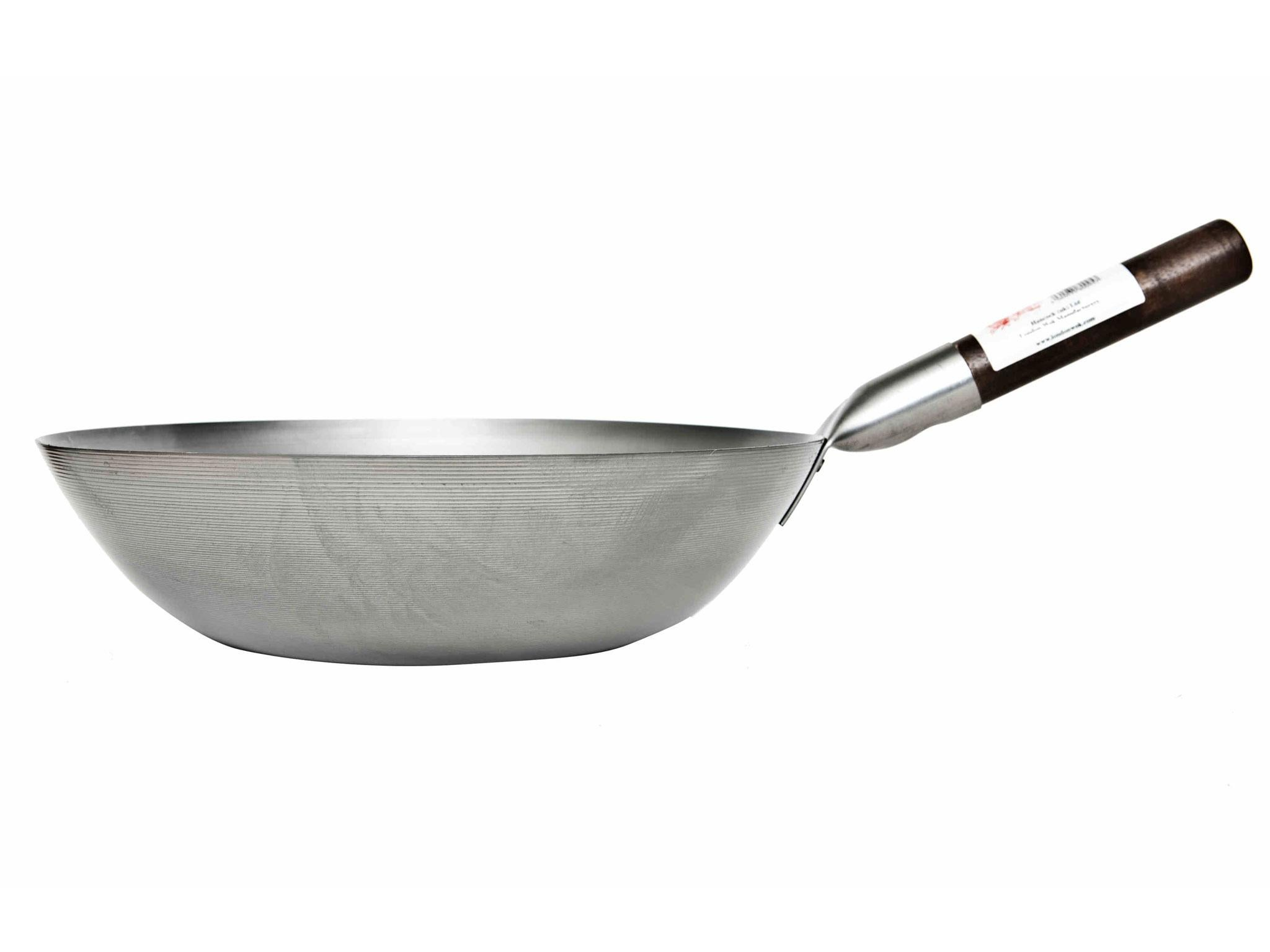 How does the wok pan differ from the usual
