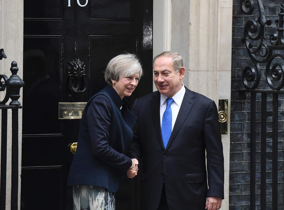 Theresa May shaking hands with Israeli Prime Minister Benjamin Netanyahu after Netanyahu arrived for a meeting at 10 Downing Street in central London