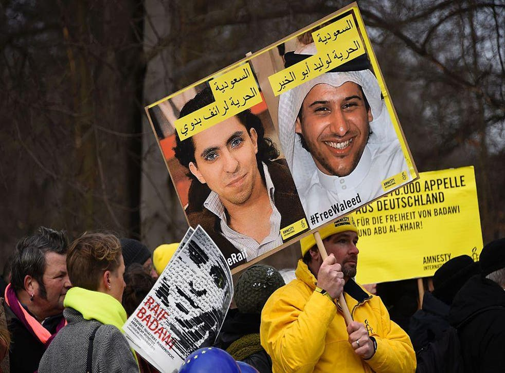 Demonstrators in Berlin protest outside Germany's Saudi Arabian embassy on January 8 2016 against the detention of Saudi blogger  Raif Badawi and human rights activist and lawyer Waleed Abu Alkhair. Both men remain in prison and face lashes for charges re