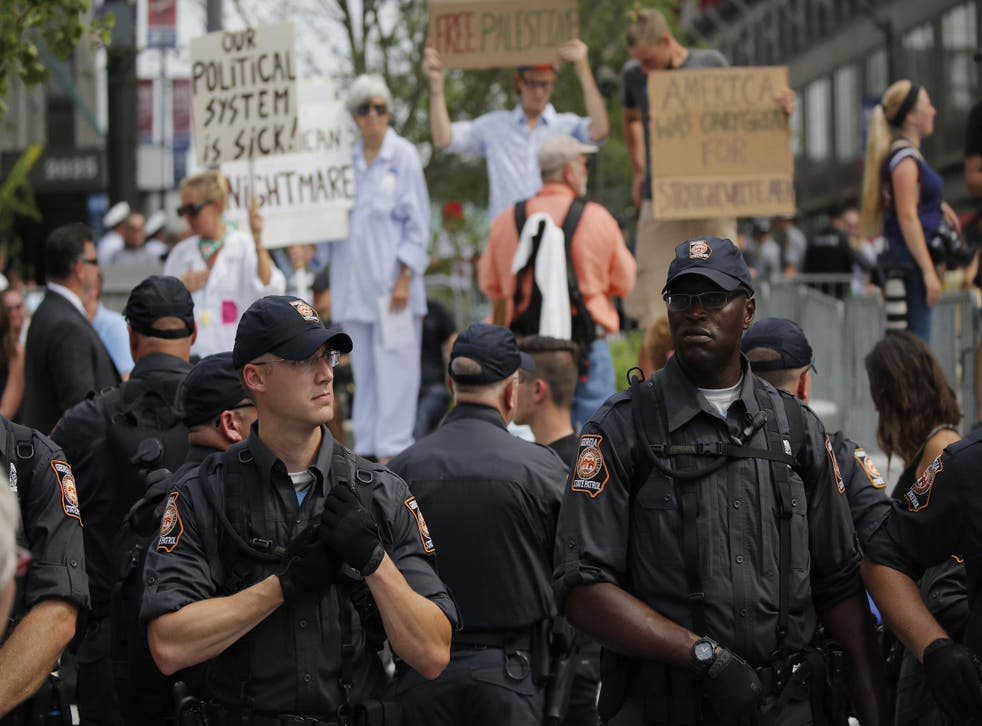 Police and protesters mingle with the public on Cleveland Public Square on the final day of the Republican National Convention on July 21, 2016 in Cleveland, Ohio.