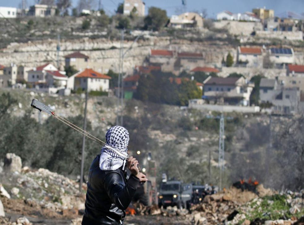 Israeli MKs narrowly voted to legalise settlements built on Palestinian land