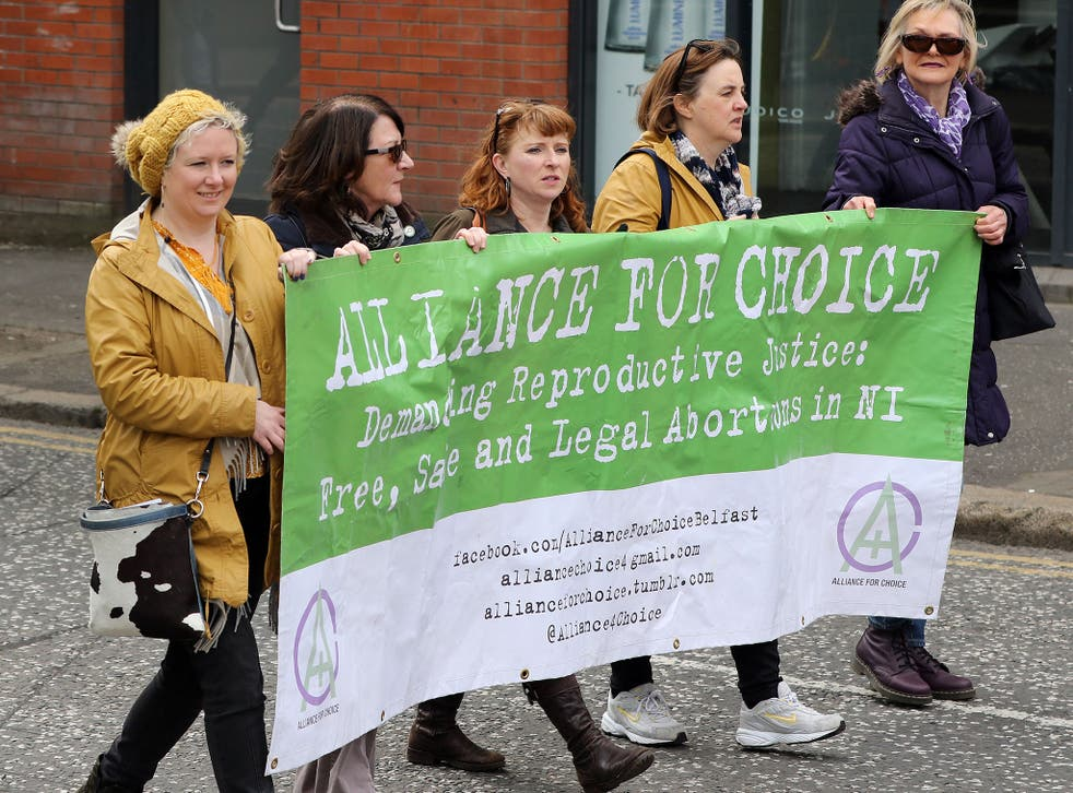 Pro-choice campaigners taking part in a demonstration through Belfast city centre in protest at Northern Ireland's restrictive abortion law