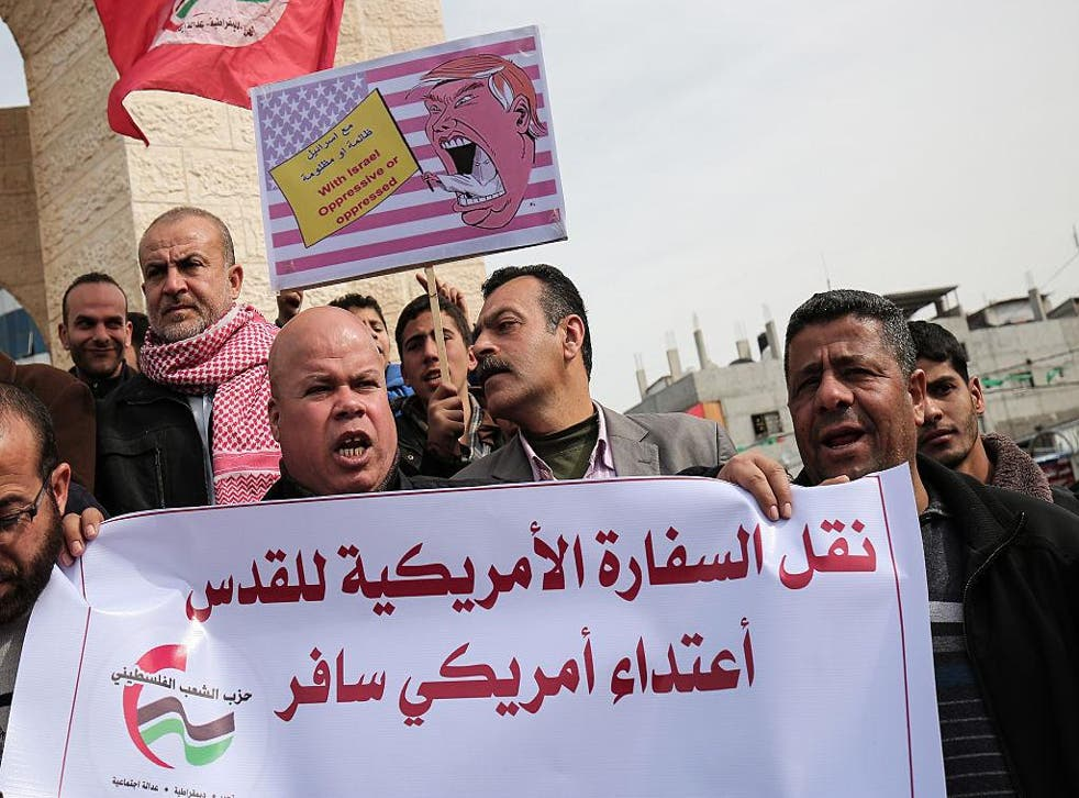 Palestinians protest against Donald Trump's campaign promise to move the US Embassy to Israel to the contested city of Jerusalem in a protest in Rafah, Gaza on January 24, 2017