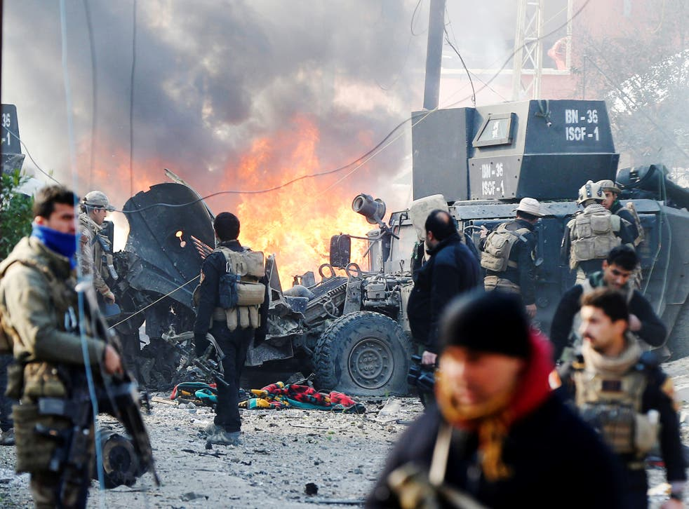 The devastation of a car bomb as Iraqi special forces attempt to clear Isis from the Al Andalus district of Mosul last month