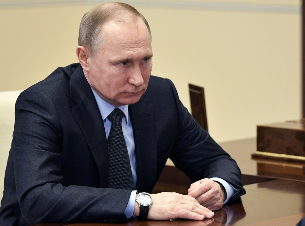 Russian President Vladimir Putin attends a meeting outside Moscow on 7 Febuary