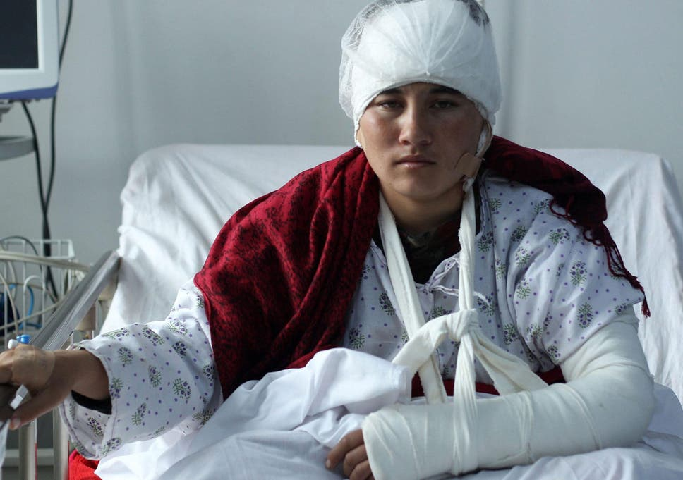 Afghan woman has ears cut off by 'suspicious' husband in middle of