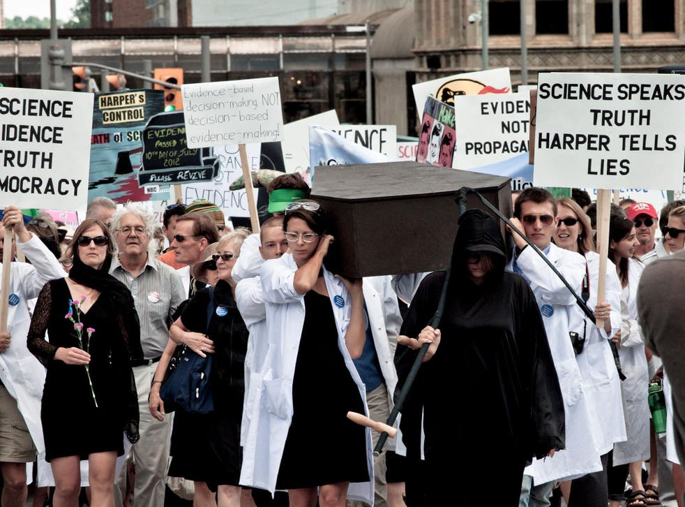 Rage of reason: hundreds of scientists hold a mock funeral for the 'death of scientific evidence' outside the Canadian parliament in July 2012