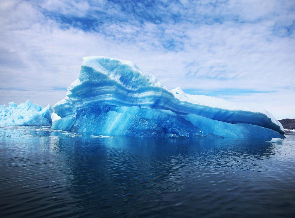 Calved icebergs from the nearby Twin Glaciers are seen floating on the sea off Qaqortoq, Greenland