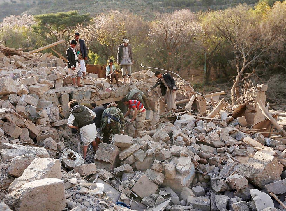 Yemenis inspect damaged houses following reported Saudi-led coalition air strikes on the outskirts of the Yemeni capital Sana'a