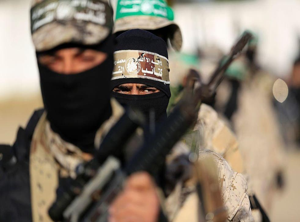 Palestinian militants of the Hamas movement take part in a rally in Gaza