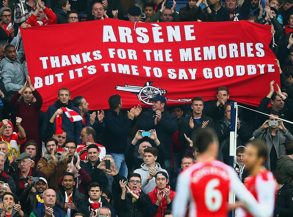 Arsenal supporters unfurl a banner in protest against Wenger's management during the 2015/16 season