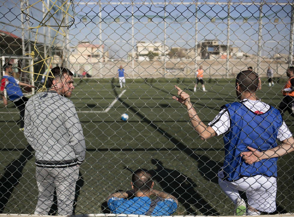 In this Wednesday, 8 February 2017 photo, Mosul residents play soccer on a pitch in the liberated eastern part of the city