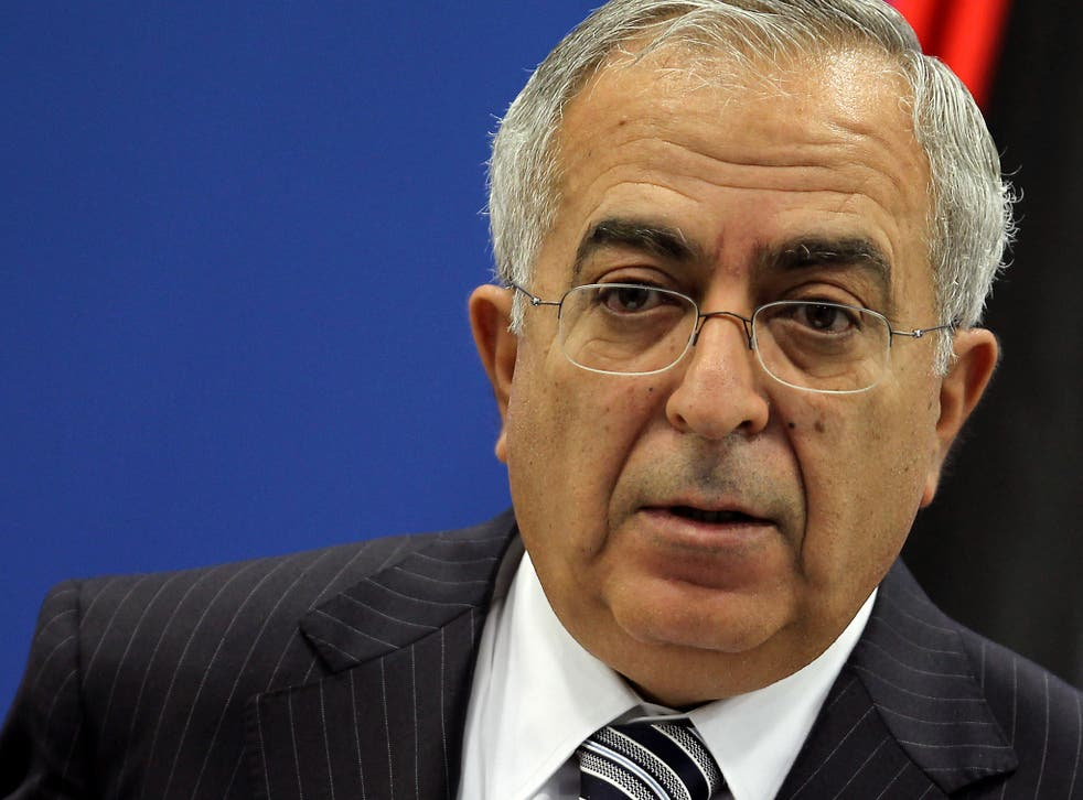 Former Palestinian Prime Minister Salam Fayyad holds a press conference in Ramallah in 2012