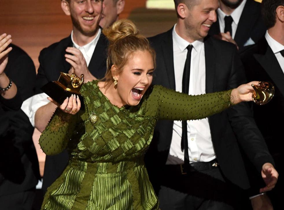 Adele snapped her Grammy in two, offering the other half to Beyoncé