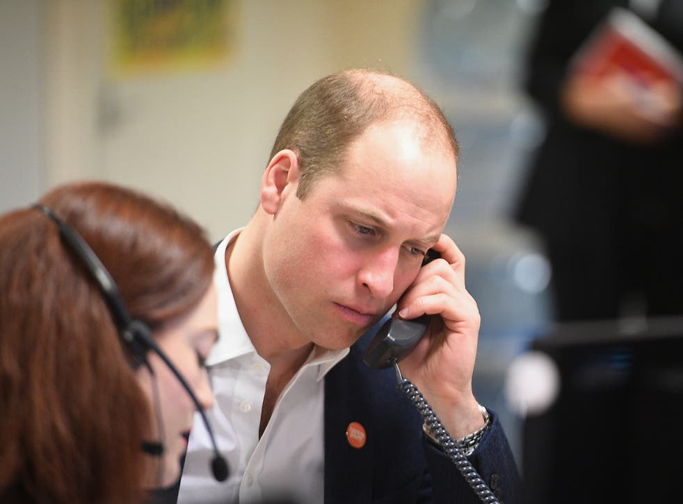 The Prince listens as adviser Carys Lewis takes the helpline's first call