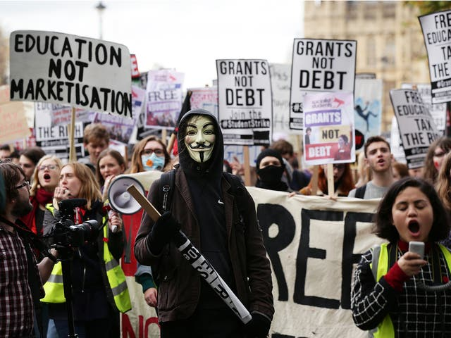 Students during a protest calling for the abolition of tuition fees and an end to student debt in Westminster, London.