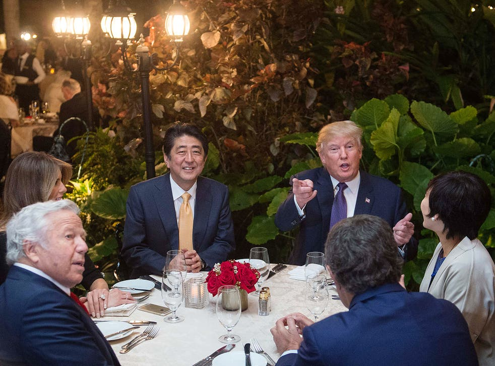 Donald Trump hosted Shinzo Abe, the Japanese Prime Minister, at his Mar-a-Lago club. The pair were pictured discussing how to respond to North Korea's latest missile test.
