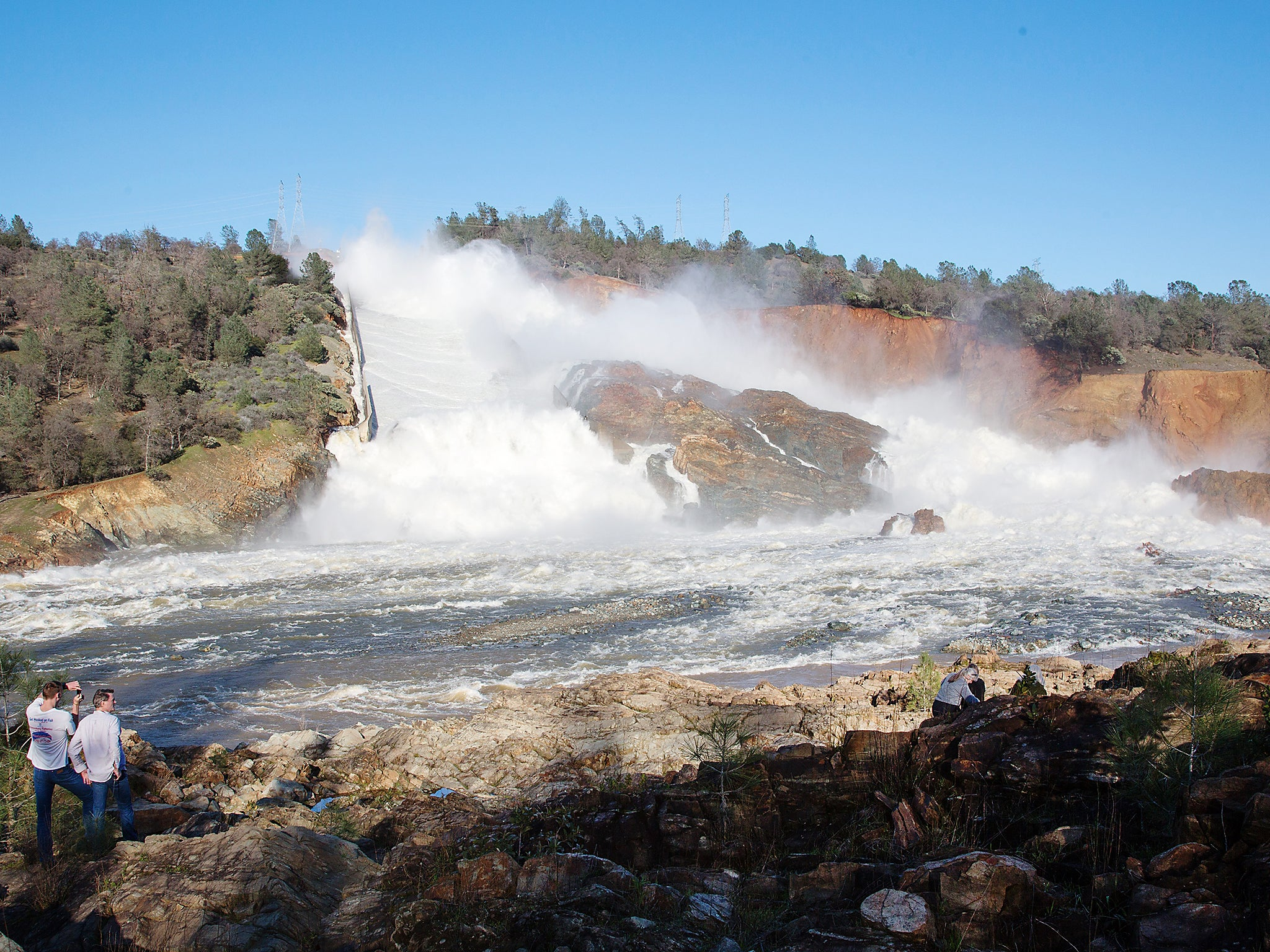 Oroville dam: Incredible photos show water cascading down hill amid