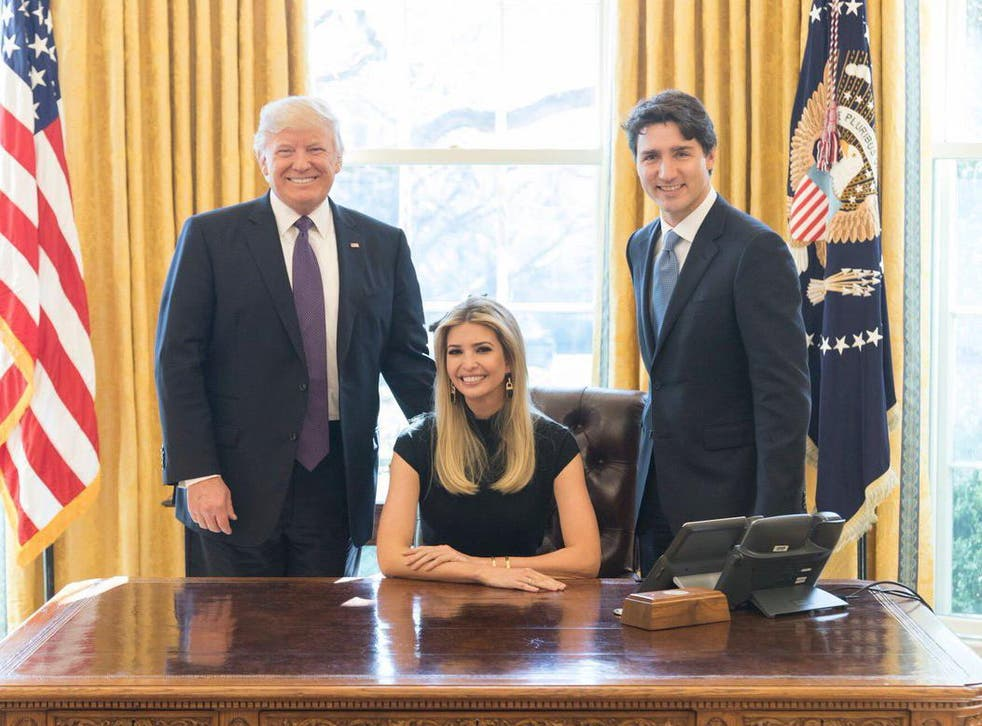Ivanka Trump sits between her father, Donald Trump, and Canadian Prime Minister Justin Trudeau in the Oval Office