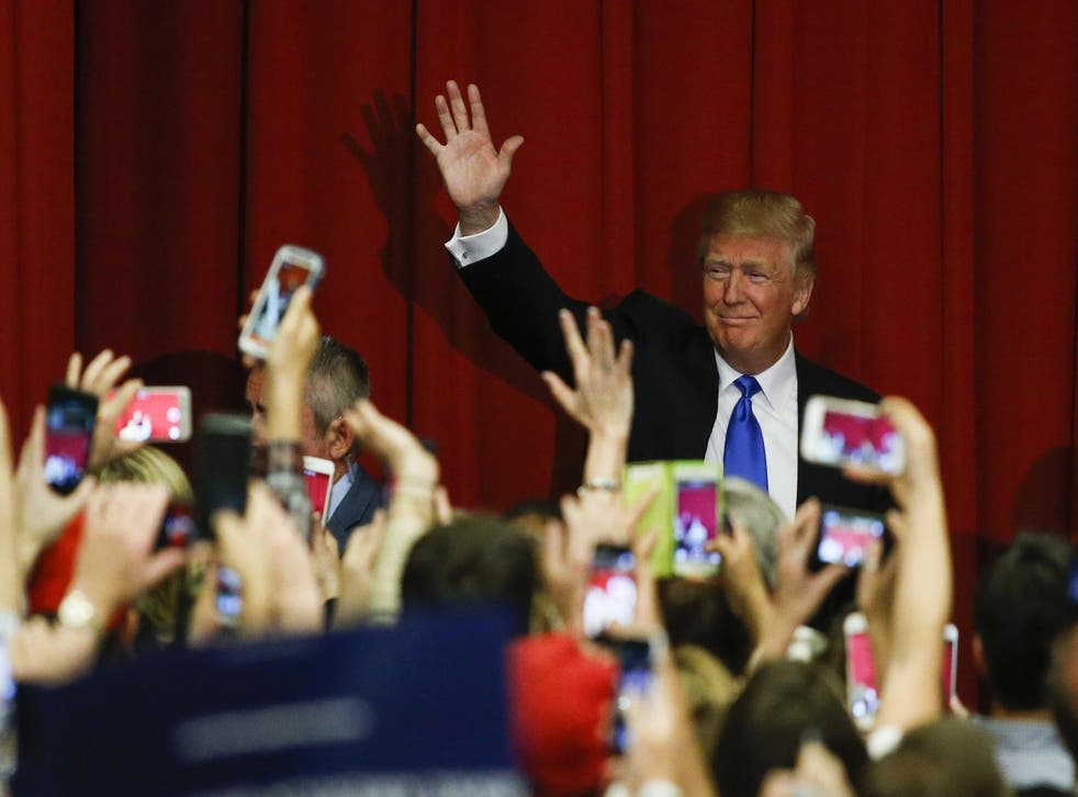 Republican presidential candidate Donald Trump waves to the crowd at a fundraising event in Lawrenceville, New Jersey on May 19, 2016