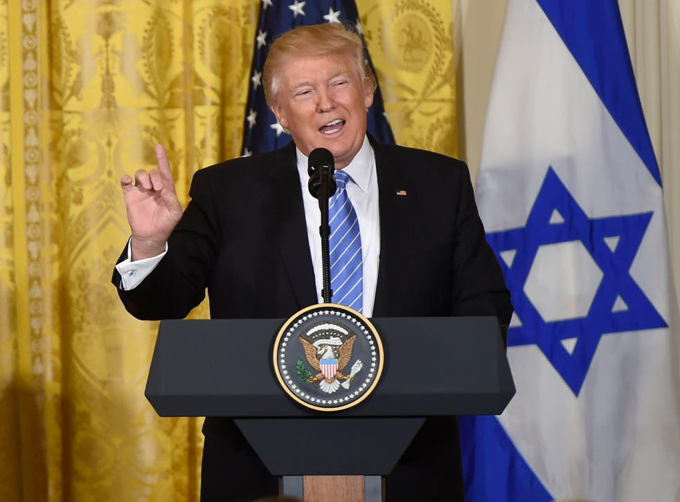 Trump speaks to reporters during a press conference with Israeli PM Netanyahu
