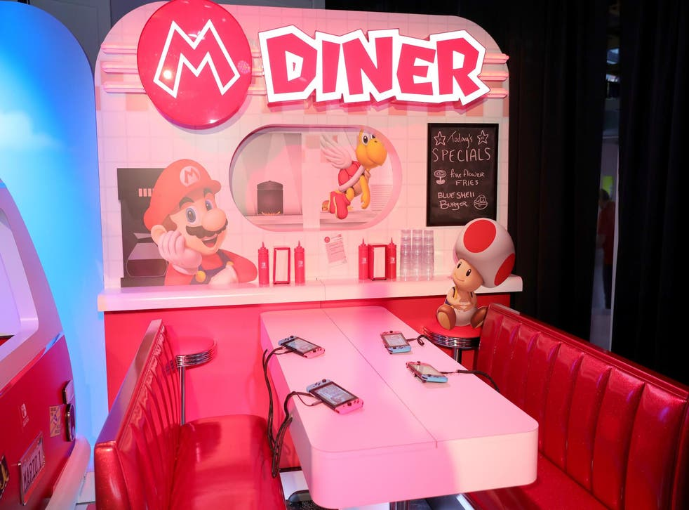 A view of a diner themed gameplay area showcasing the mobility of the Nintendo Switch console at a special press event in New York on Jan. 13, 2017