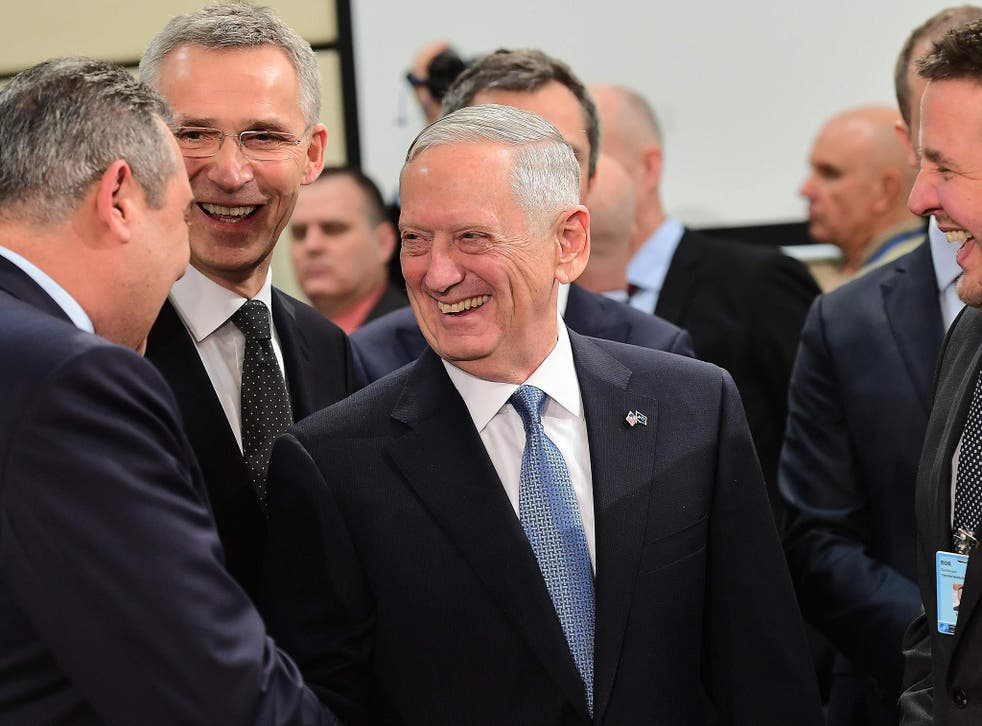 US Defence Minister James Mattis (C), NATO Secretary General Jens Stoltenberg (2ndL) and Greece's Defence Minister Panos Kammenos (L) attend a NATO defence ministers meeting at NATO headquarters in Brussels