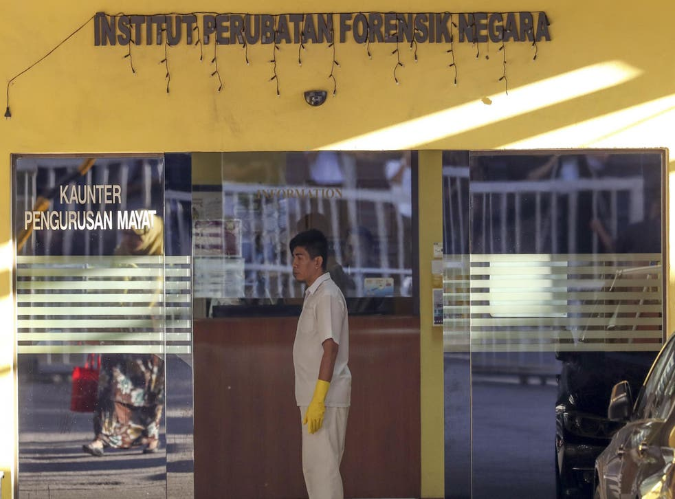A medical staff member stands at the entrance of the forensic department at a hospital in Kuala Lumpur, Malaysia, where the autopsy of Mr Kim's body was carried out