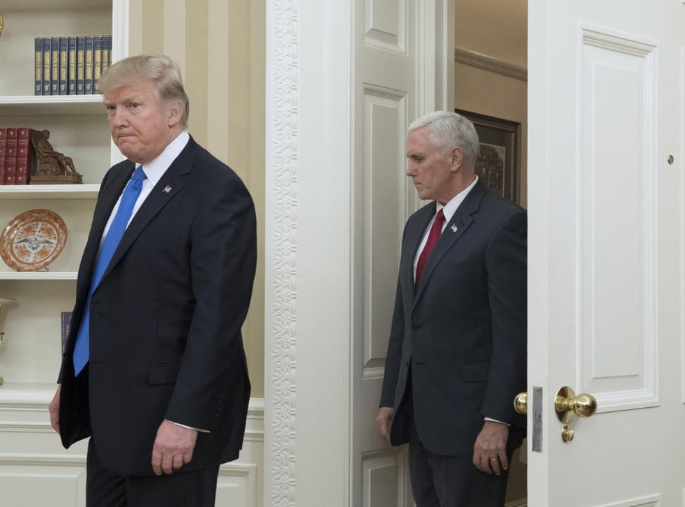 US President Donald J. Trump (L) and US Vice President Mike Pence (R) enter the Oval Office