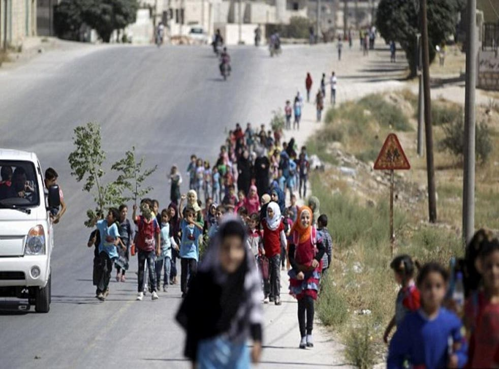 Children walk to school in Idlib province, where religious police have been rigorously enforcing their interpretation of sharia-compliant dress codes for women and girls