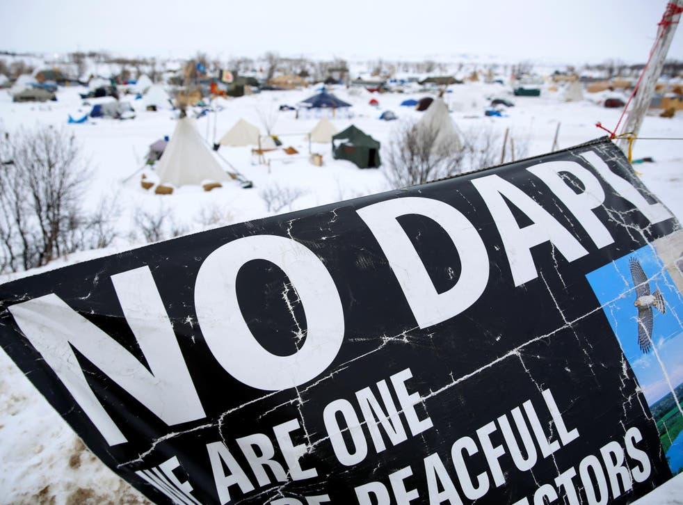 A banner flies in the Dakota Access Pipeline protest camp near Cannon Ball, North Dakota