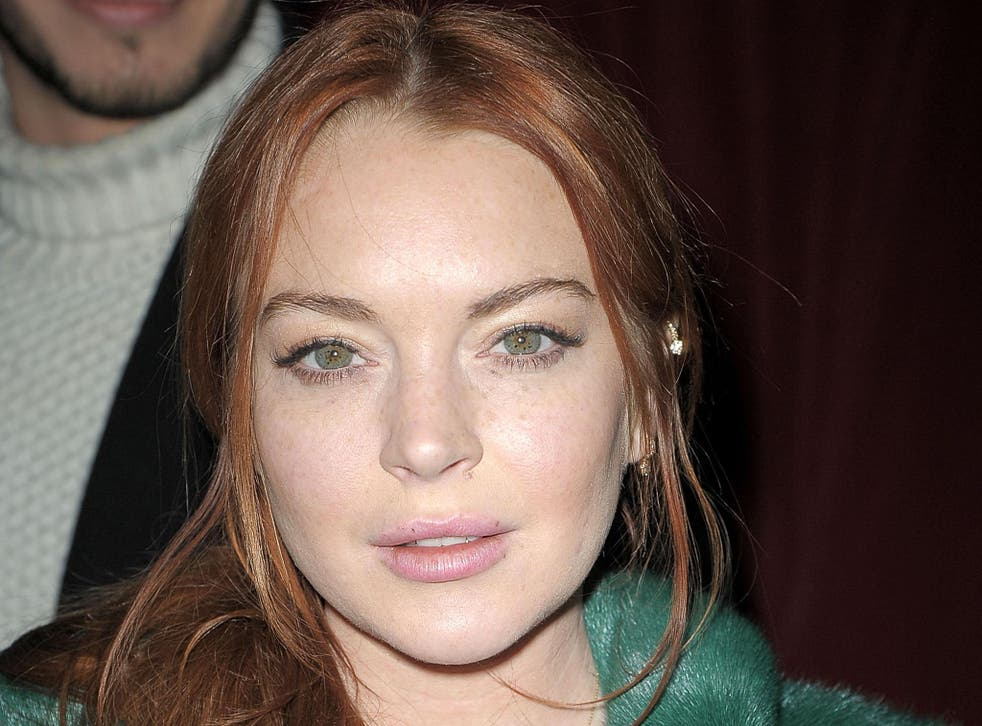 Lindsay Lohan, pictured at a fashion show New York City in February, says she has not converted to Islam - yet